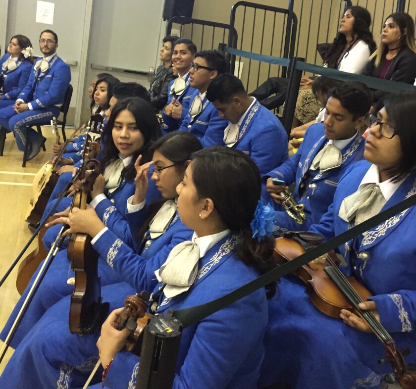 Members of Los Jaguares, the Mendez High School mariachi group, wait to perform at the graduation ceremony.