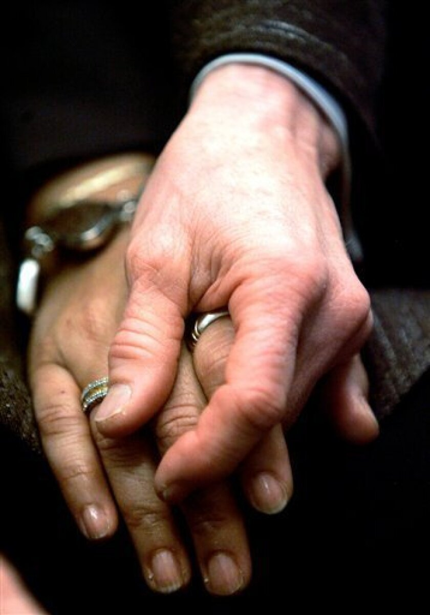 FILE - In this file photo from March 4, 2008, Diane Sabin and her partner Jewelle Gomez hold hands in San Francisco. The lawyers in the landmark federal trial over the constitutionality of California's gay marriage ban may have to check their dazzling oratory at the courtroom door during next week'