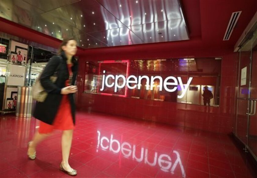 A customer leaves a J.C. Penney store, Tuesday, April 9, 2013 in New York. J.C. Penney is hoping its former CEO can revive the retailer after a risky turnaround strategy backfired and led to massive losses and steep sales declines. The company's board of directors ousted CEO Ron Johnson after only
