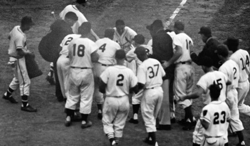 St. Louis' Stan Musial is congratulated at home plate by his NL teammates after hitting a walk-off home run in the 12th inning of the 1955 All-Star Game at Milwaukee's County Stadium.