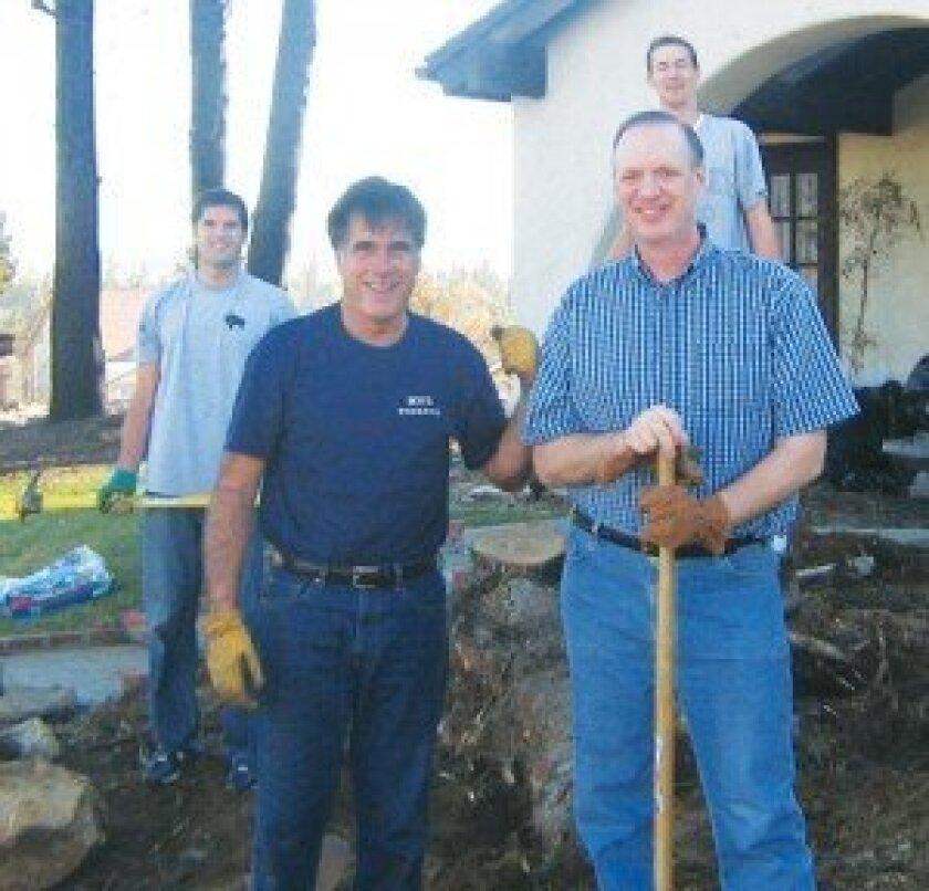 Mitt Romney and Jim Davies. Behind them are Matt Romney and Greg Davis.