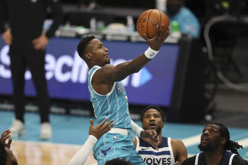 Charlotte Hornets guard Terry Rozier drives to the basket against the Minnesota Timberwolves during the second half of an NBA basketball game in Charlotte, N.C., Friday, Feb. 12, 2021. (AP Photo/Nell Redmond)