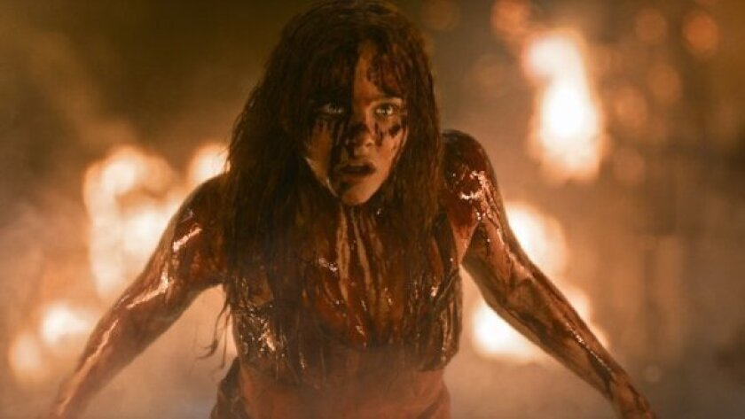 """""""Gravity"""" was the No. 1 film at the box office for the third consecutive weekend, beating newcomer """"Carrie"""""""