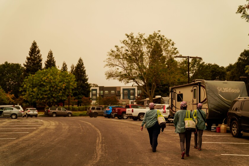 Nurses Jenn Ellis, Blanca Ramirez, and  Bindhi Millar walk the parking lot of the Vacaville Community Center