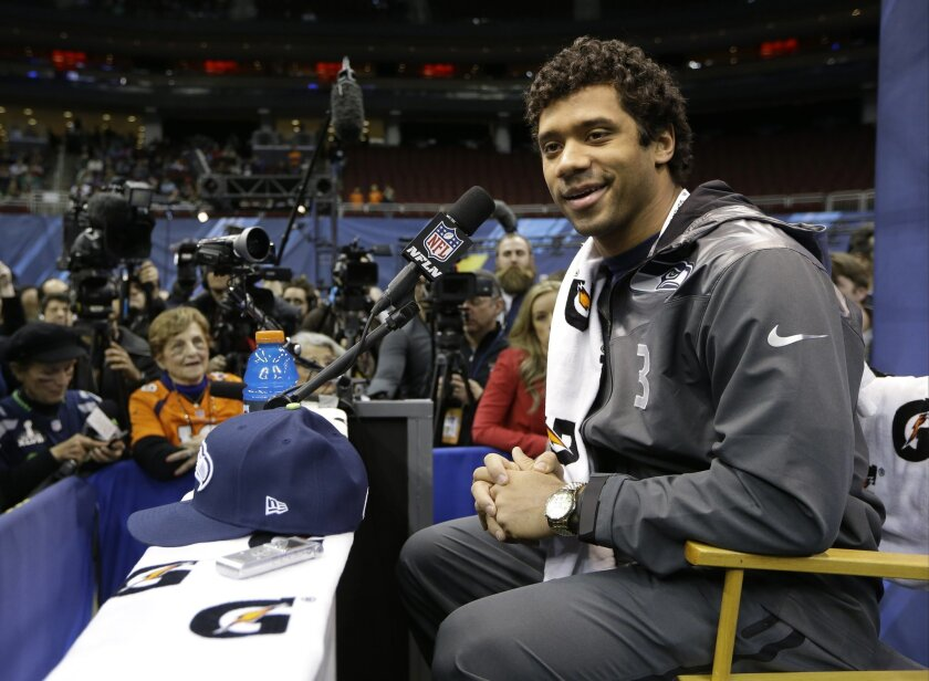 Seattle Seahawks' Russell Wilson answers a question during media day for the NFL Super Bowl XLVIII football game Tuesday, Jan. 28, 2014, in Newark, N.J. (AP Photo/Mark Humphrey)