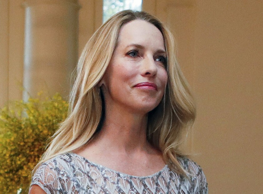 FILE - In this Aug. 2, 2016, file photo, philanthropist Laurene Powell Jobs arrives for a State Dinner at the White House in Washington. Jobs, the widow of Apple founder Steve Jobs, will invest $3.5 billion within the next 10 years to address the climate crisis, a spokesperson for Emerson Collective, Jobs' organization, said on Monday, Sept. 27, 2021. (AP Photo/Pablo Martinez Monsivais, File)