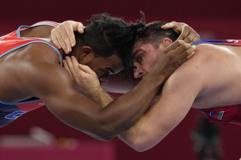 Cuba's Reineris Salas Perez, left, competes a