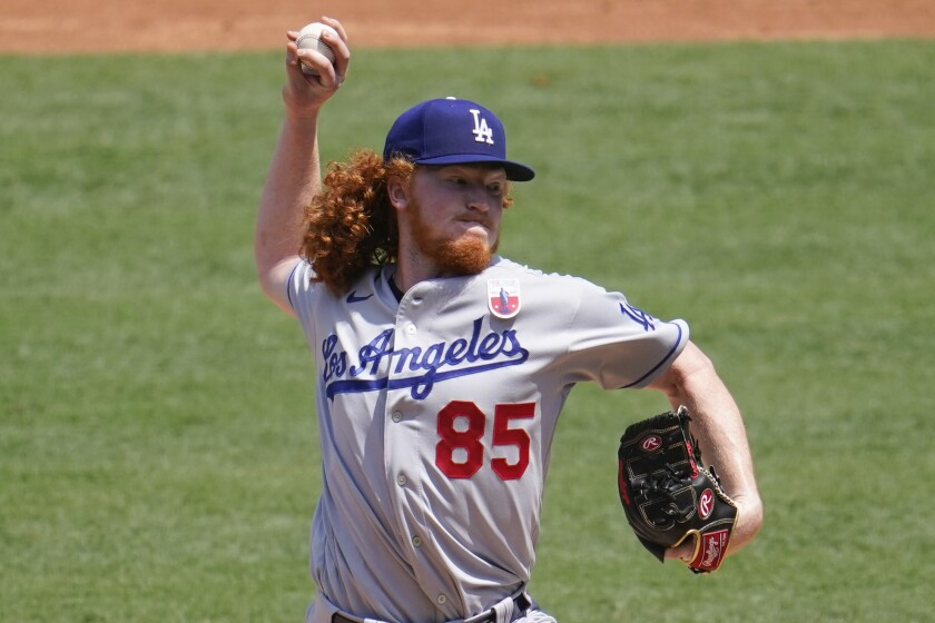 Dodgers starting pitcher Dustin May delivers against the Angels on Aug. 16.