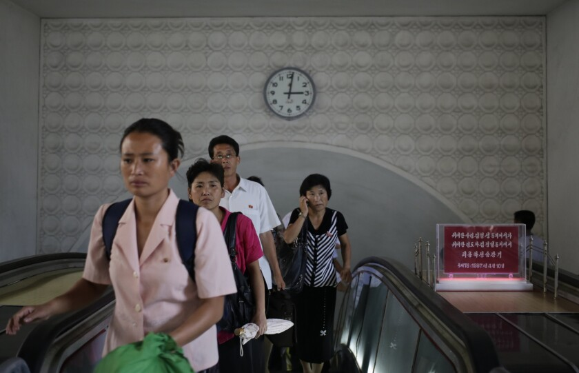 North Koreans leave an underground train station in Pyongyang on Sept. 1, 2014.