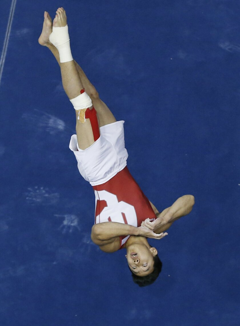 Oklahoma's Kanji Oyama competes in the floor exercise during the preliminary round of the NCAA men's gymnastics championships in Norman, Okla., Thursday, April 9, 2015. (AP Photo/Sue Ogrocki)