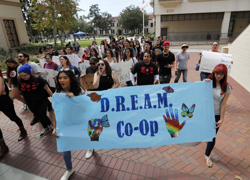 Students march around campus during a rally in solidarity with Deferred Action for Childhood Arrival