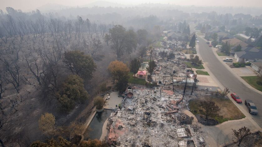 The deadliest fire in California so far this year, the Carr fire in Shasta and Trinity counties, was fully contained Thursday night, officials said. Pictured above are homes destroyed in the Mary Lake Subdivision.