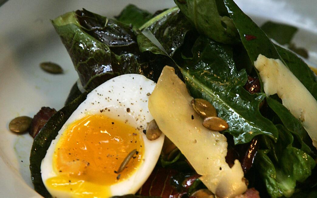 Warm Treviso radicchio and dandelion salad with soft-cooked egg