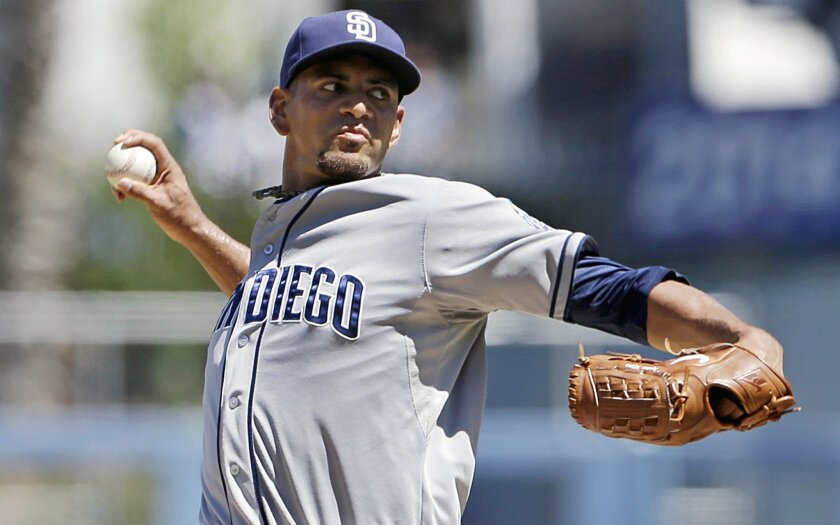 Padres starter Tyson Ross delivers a pitch in the first inning against the Dodgers on Sunday.