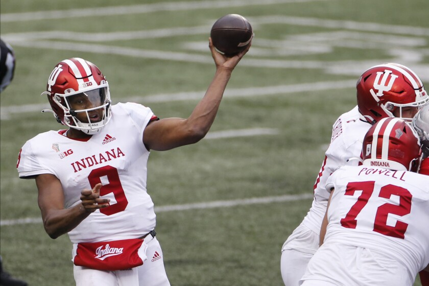 Indiana quarterback Michael Penix throws a pass against Ohio State during the second half of an NCAA college football game Saturday, Nov. 21, 2020, in Columbus, Ohio. Ohio State beat Indiana 42-35. (AP Photo/Jay LaPrete)