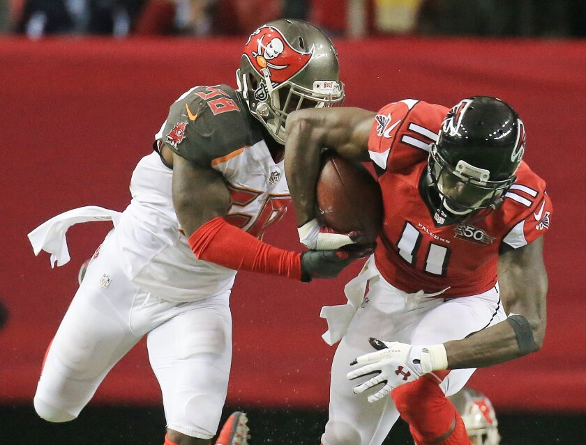 Tampa Bay  Buccaneers linebacker Kwon Alexander tries to take the ball away from Atlanta Falcons wide receiver Julio Jones for the turnover during an NFL football game on Sunday, Nov. 1, 2015, in Atlanta. (Curtis Compton/Atlanta-Journal Constitution via AP) MARIETTA DAILY OUT, GWINNETT DAILY POST O