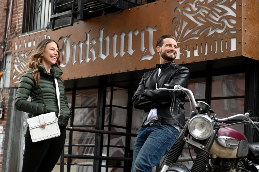 """Liza, played by Sutton Foster, and her on-again, off-again boyfriend, Josh, played by Nico Tortorella, chat outside his tattoo parlor on """"Younger."""""""