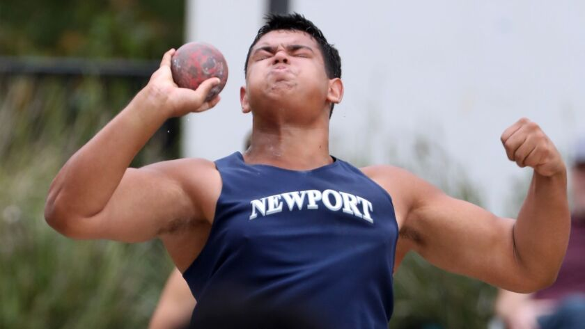 Newport Harbor High School Aidan Elbettar throws the shot put in the Division 2 boys shot-put event