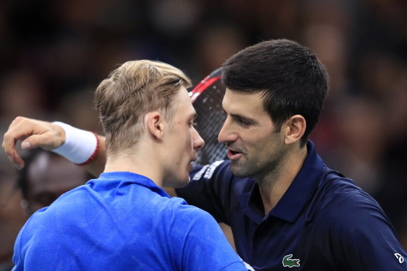 Novak Djokovic of Serbia greets Denis Shapovalov of Canada, left, after winning the final match of the Paris Masters tennis tournament in Paris, Sunday, Nov. 3, 2019. Djokovic defeated Shapovalov of Canada 6-3/6-4. (AP Photo/Michel Euler)