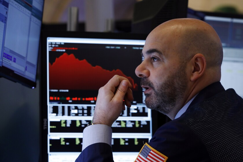 Trader Fred DeMarco works on the floor of the New York Stock Exchange.