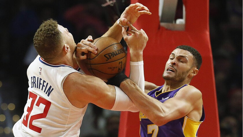 Clippers forward Blake Griffin is tied up for a jump ball with Lakers forward Larry Nance Jr. on Nov. 27.