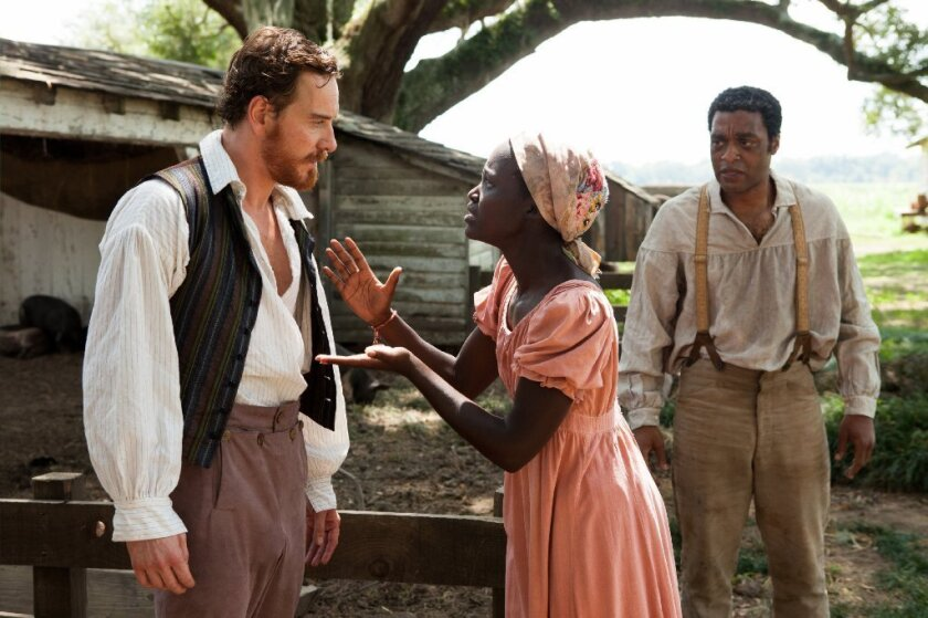 """Michael Fassbender, left, Lupita Nyong'o and Chiwetel Ejiofor star in the historical drama """"12 Years a Slave."""""""