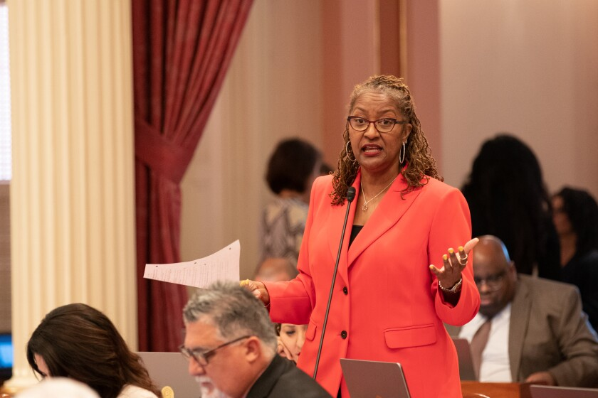 State Sen. Holly Mitchell (D-Los Angeles) discusses legislation during Senate floor debate at the Capitol on Aug. 29.