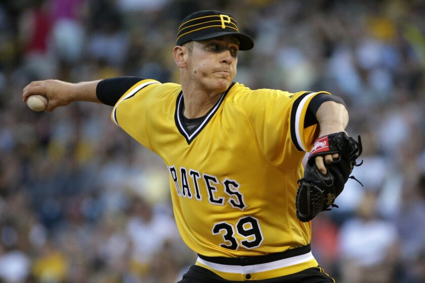 Pittsburgh Pirates starting pitcher Chad Kuhl delivers in the first inning of a baseball game against the Los Angeles Dodgers in Pittsburgh, Sunday, June 26, 2016. It was Kuhl's major league debut. (AP Photo/Gene J. Puskar)