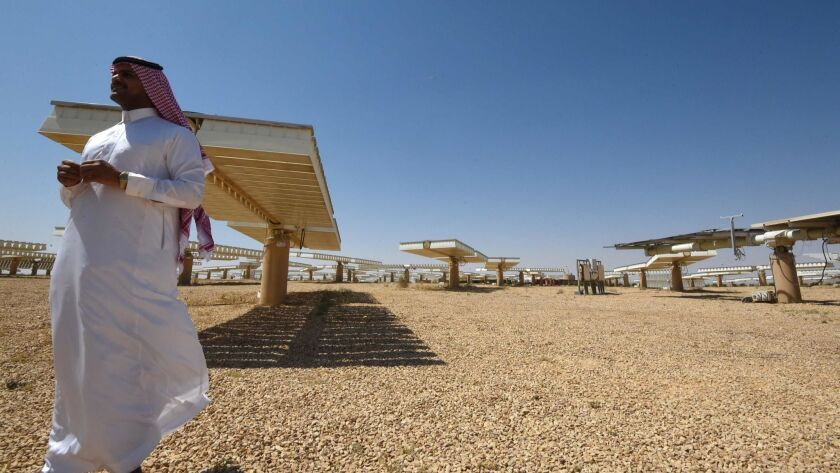 A Saudi man stands at a solar plant in Uyayna, north of Riyadh, in March.