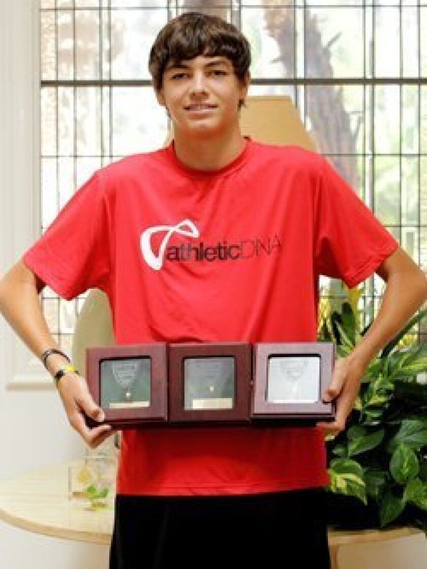 Taylor Fritz with some of his awards
