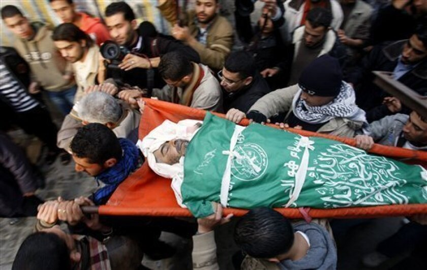 Palestinians carry the body of a 65 years old man they say was killed by the Israeli army, during his funeral in Beit Lahiya, northern Gaza Strip, Monday, Jan. 10, 2011. According to Palestinian witnesses in Gaza, a 65 year old man was killed by Israeli forces Monday, the Israeli army spokesman said the incident was under investigation. (AP Photo/Hatem Moussa)