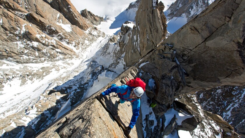 "Ben Briggs on the first exposed gendarme on the Diables arete in a scene from ""Mountain."" Credit: Gr"