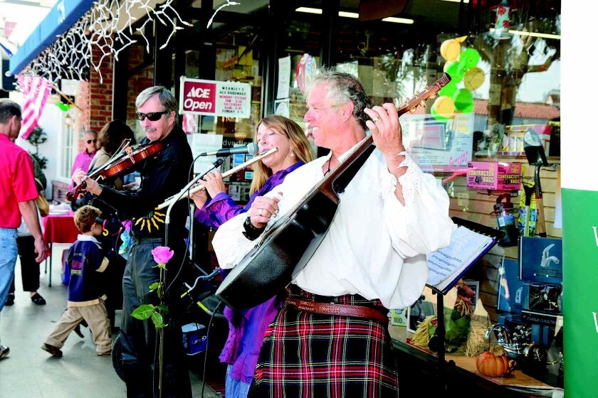 Entertainers add to the scene on Girard Avenue during the 2009 open house.