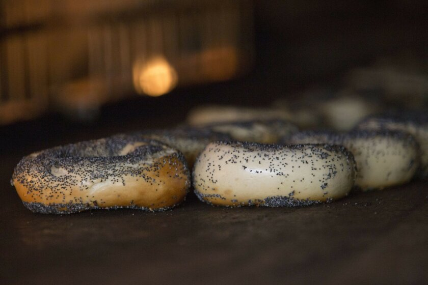 Bagels are seen in the wood burning oven at Black Seed bagel shop in the East Village neighborhood of New York on Friday, May 27, 2016. (AP Photo/Mary Altaffer)