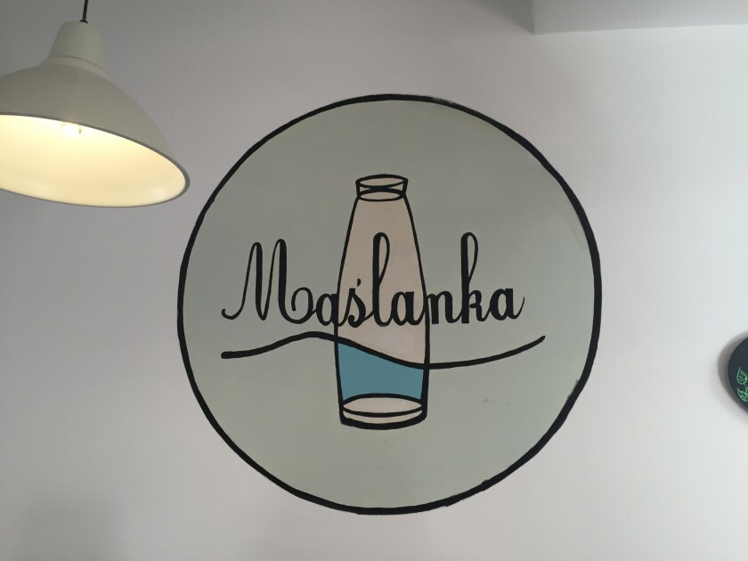 Maslanka's logo, one of the milk bars in Warsaw.