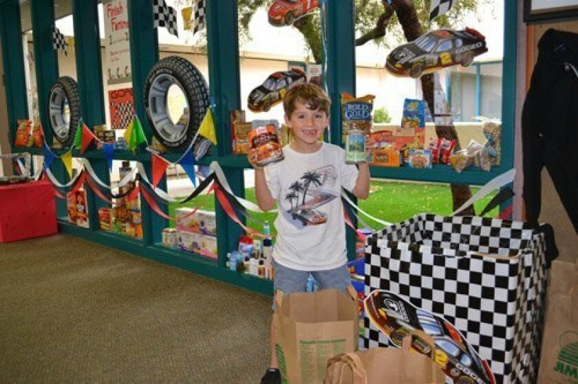 (Above) Ronin Mortimer helped collect and organize the cans and personal care items.