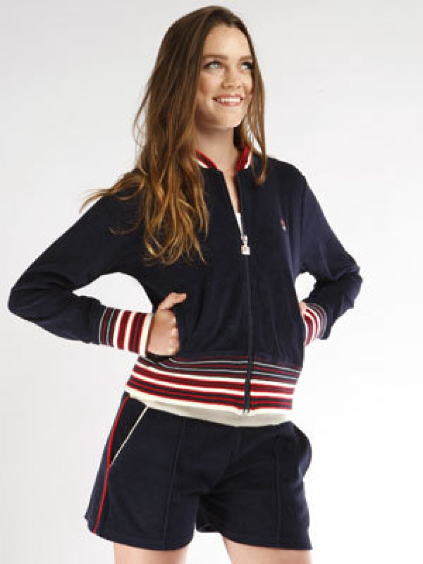 Terry warmup jacket in navy, $90, and short-shorts, $58, with red and white trim.