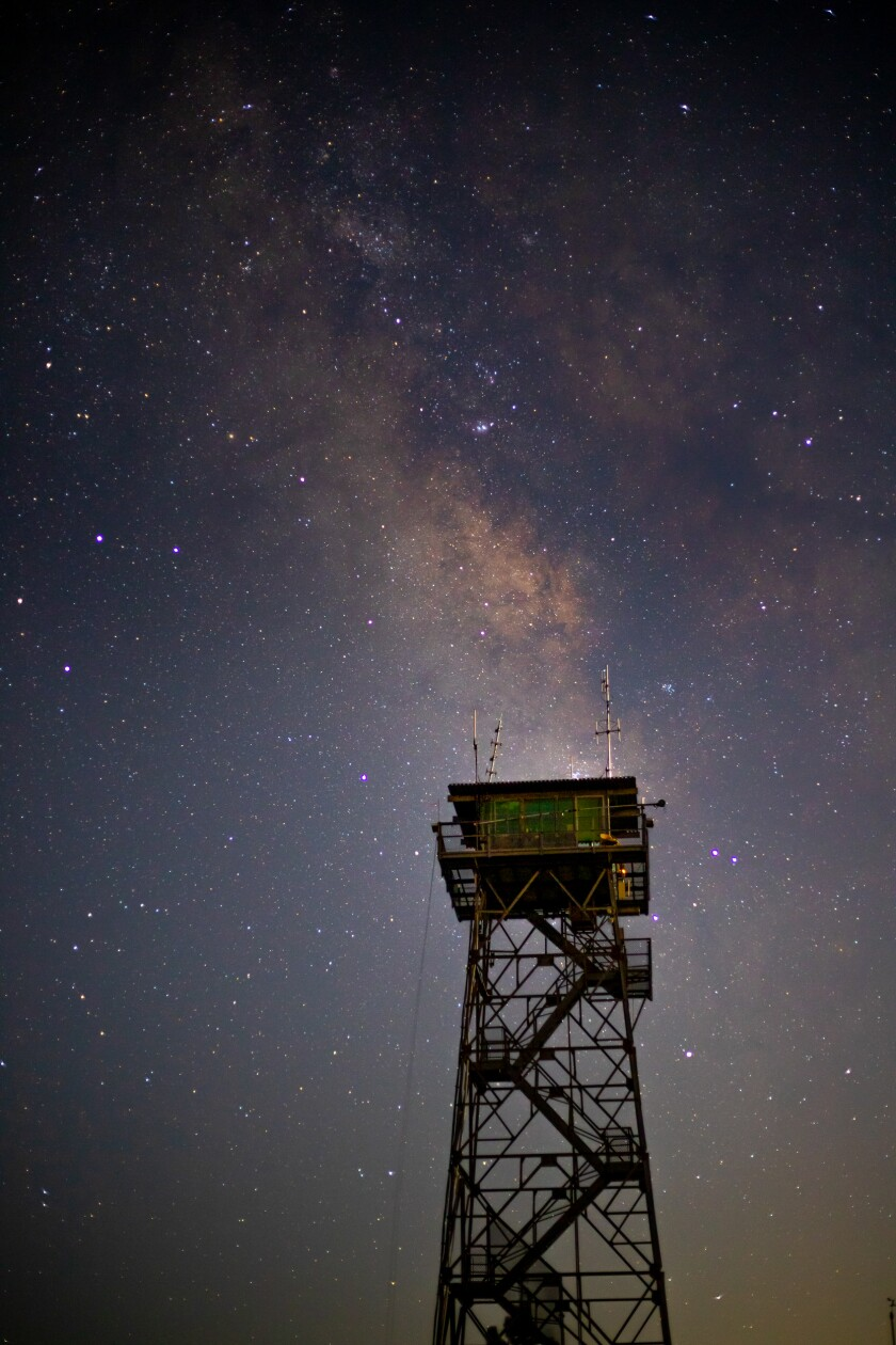 The High Point fire lookout tower at night with the summer Milky Way overhead.