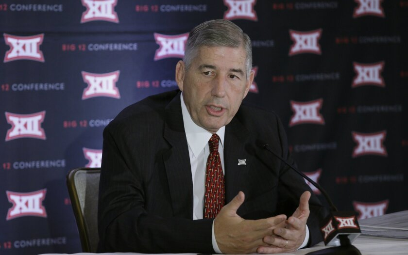 Commissioner of the Big 12 Bob Bowlsby speaks to reporters after the first day of the Big 12 sports conference meeting in Irving, Texas, Wednesday, June 1, 2016. (AP Photo/LM Otero)