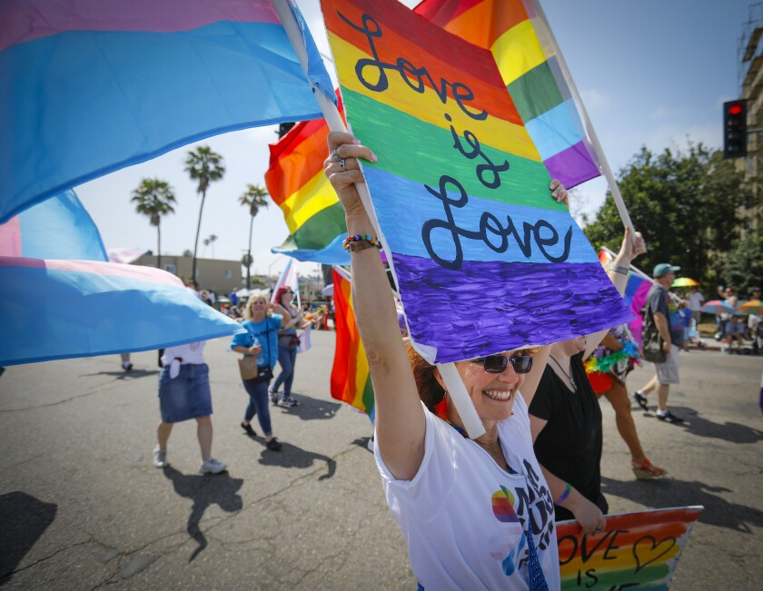 Syndee Wood walks with the North County LGBTQ Resource Center contingent during the annual San Diego Pride Parade.
