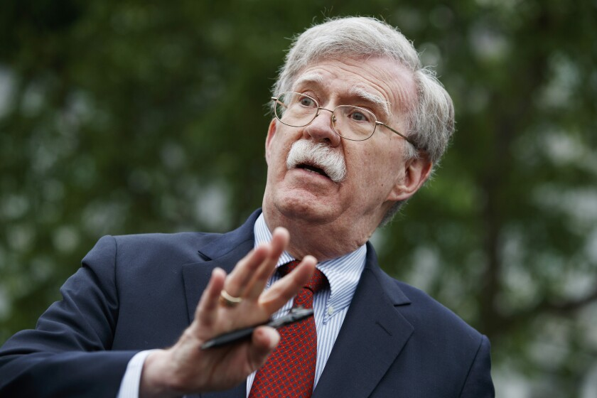 John Bolton talks to reporters outside the White House on May 1.