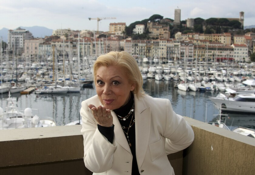 FILE - In this Tuesday Jan. 26, 2010 file photo, Italian opera soprano Mirella Freni poses at the 44th MIDEM (International record music publishing and video music market) in Cannes, southern France. Mirella Freni, an Italian soprano whose uncommon elegance and intensity combined with a sumptuous voice and intelligence to enthrall opera audiences for a half-century, has died at age 84. Freni's manager said she died Sunday Feb. 9, 2020 at her home in Modena, Italy. (AP Photo/Lionel Cironneau, File)