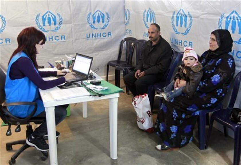 A Syrian family who fled their home from Aleppo register, at the UNHCR center in the northern city of Tripoli, Lebanon, Wednesday, March. 6, 2013.  The number of Syrians who have fled their war-ravaged country and are seeking assistance has now topped the one million mark, the United Nations' refug