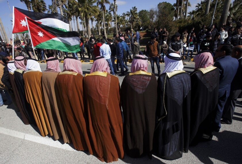 Jordanians show their support for the government against terrorism as they await King Abdullah II's return from the U.S. at Queen Alia International Airport in Amman on Feb. 4.