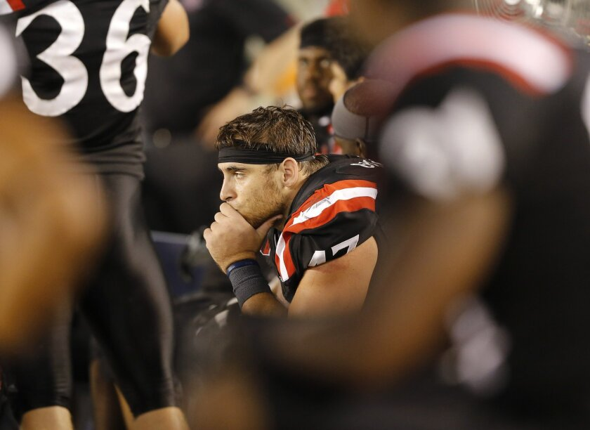 Defensive lineman Cody Galea sits dejectedly on the bench in the late 4th quarter as the Aztecs were blown out by Eastern Illinois.