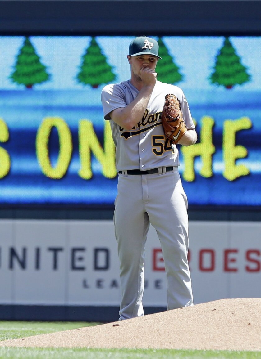 Oakland Athletics pitcher Sonny Gray loads the bases with a walk of Minnesota Twins' Miguel Sano in the third inning of a baseball game Wednesday, July 6, 2016, in Minneapolis. (AP Photo/Jim Mone)
