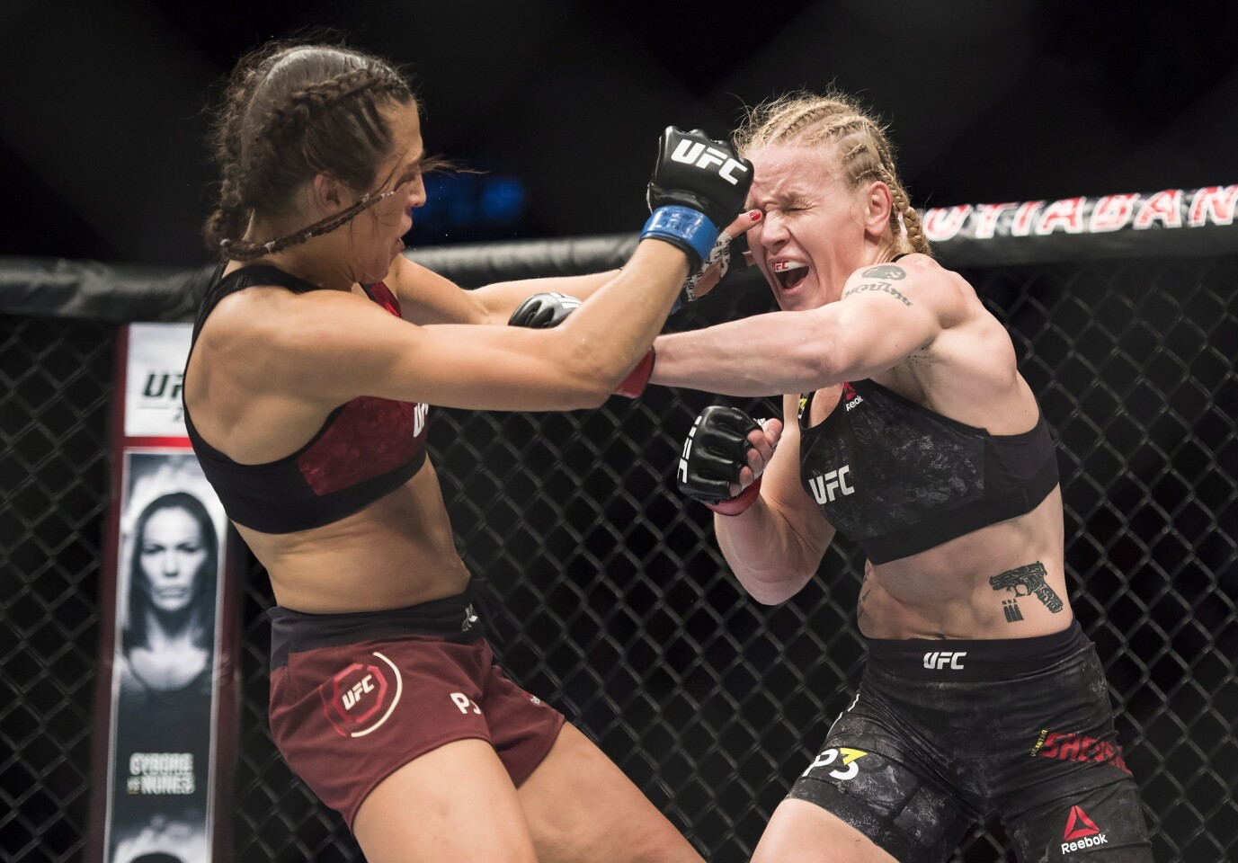 Valentina Shevchenko, right, fights Joanna Jedrzejczyk during a women's flyweight mixed martial arts bout at UFC 231 in Toronto on Saturday, Dec. 8, 2018. (Nathan Denette/The Canadian Press via AP)