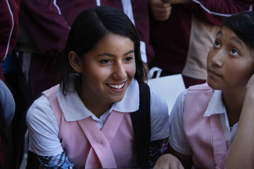 Jennifer Rivera, 12, left, and Kimberly Vera, 12 are adjusting to life as a seventh-graders at a Tijuana public school.