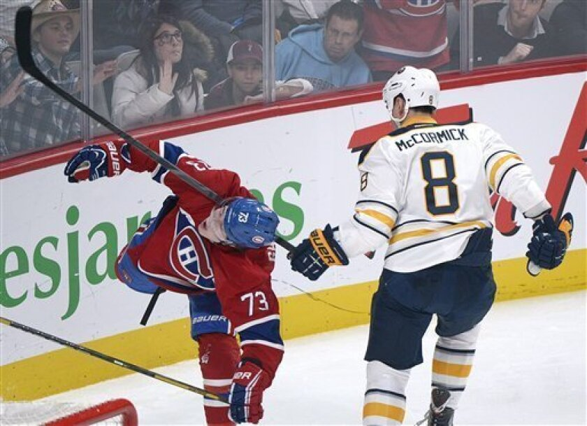 Buffalo Sabres' Cody McCormick (8) gets his stick up on Montreal Canadiens' Brendan Gallagher during the second period of  an NHL hockey game in Montreal, Saturday ,Feb. 2, 2013. (AP Photo/The Canadian Press, Graham Hughes)