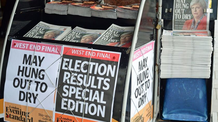 Election headlines June 9 on a newsstand at Victoria Station in London.